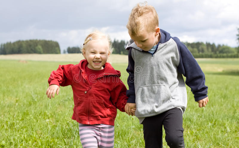 Portrait of blonde boy and girl royalty free stock photo