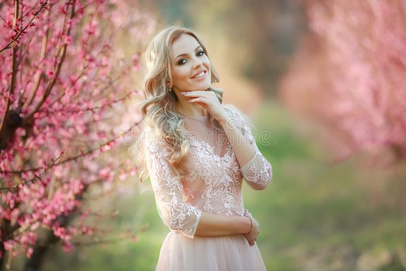 Portrait of blonde in the garden. makeup, Airy dress stock images