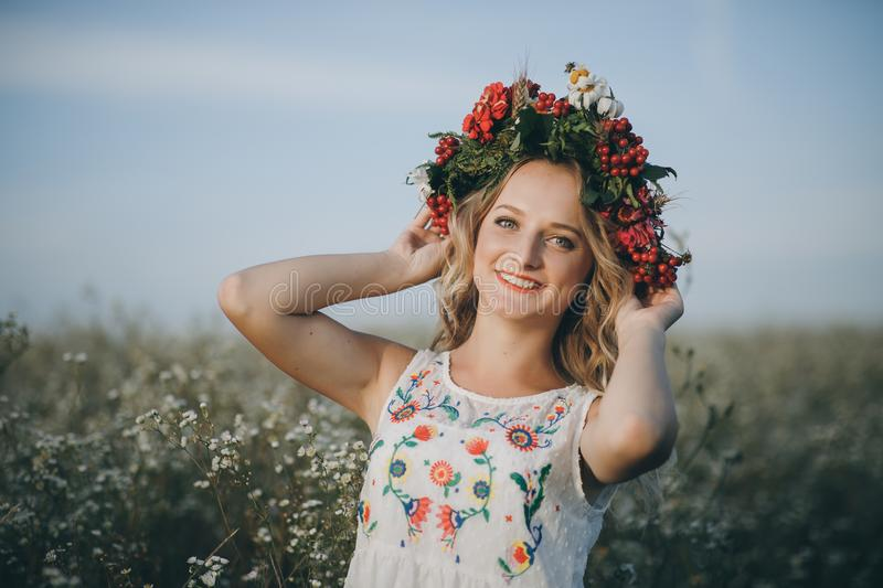 Close-up, Beauty Portrait of a blonde girl with blue eyes with a wreath of flowers on her head stock photography