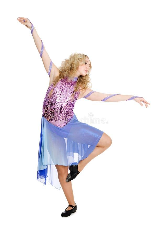 Beautiful sexy blonde girl dancing stock photo