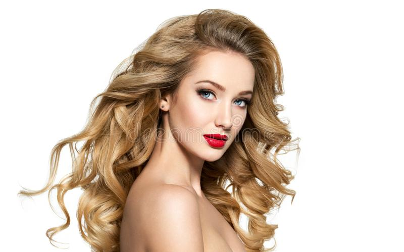 Pretty woman with long hair and red lips. stock image