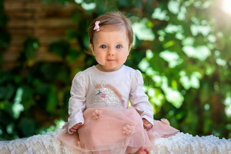 Portrait of a blue eyed baby girl stock images