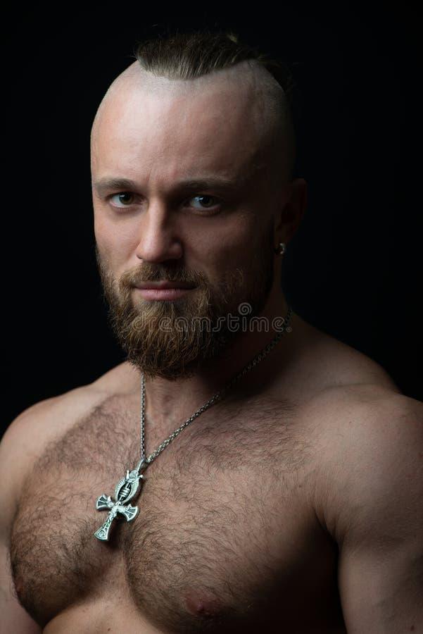 Portrait of bodybuilder. Portrait of muscular man posing in studio royalty free stock photography