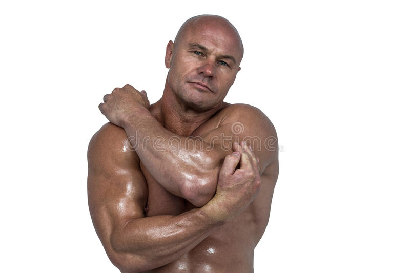 Portrait of bodybuilder stretching with hands stock images