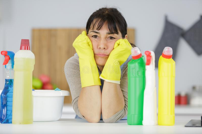 Portrait bored female house cleaner royalty free stock images