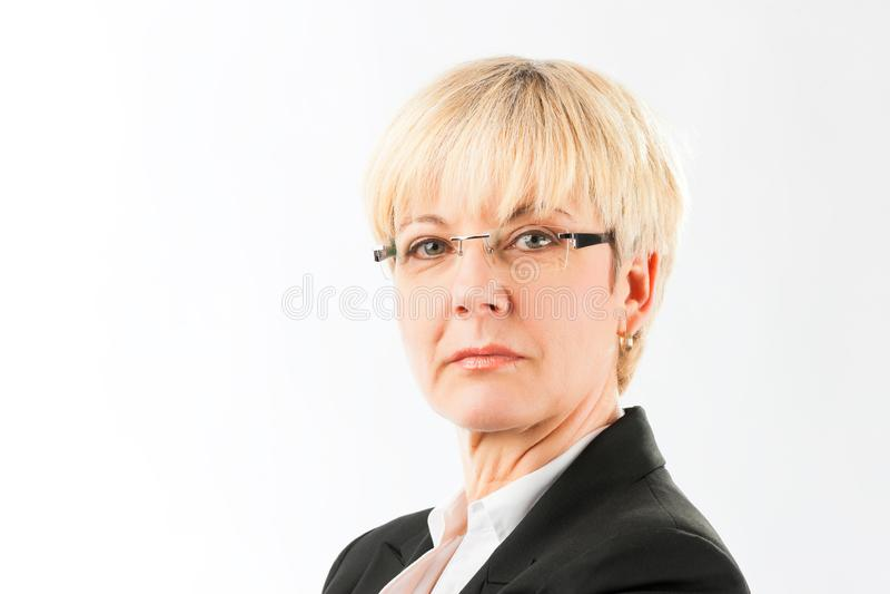 Serious senior business woman in eyeglasses royalty free stock photos