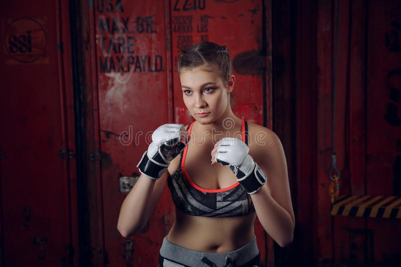 Boxer MMA female fighter posing in confident defensive stance with gloves up stock photos