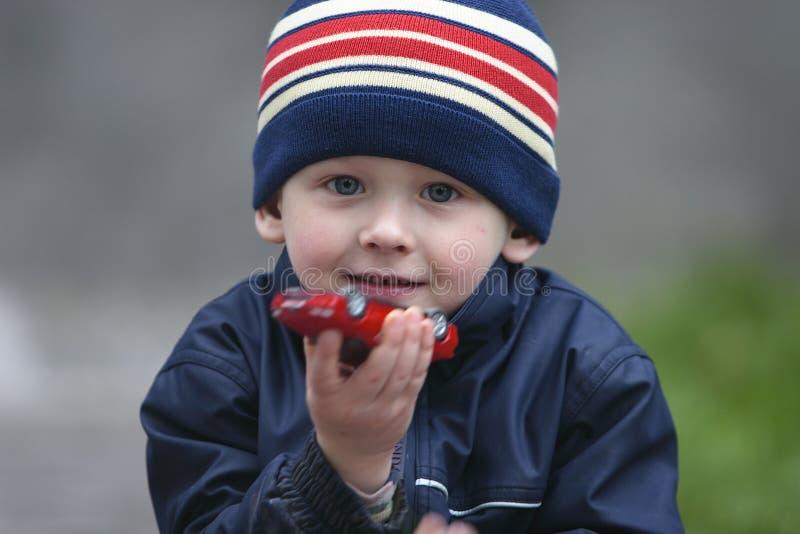 Portrait of a boy. Boy with a favourite car model stock photos