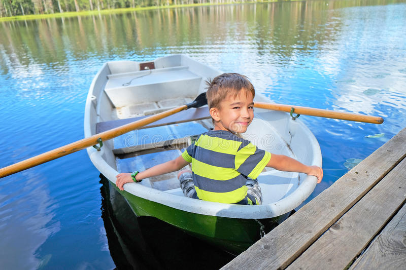 Portrait of a boy in a boat stock image