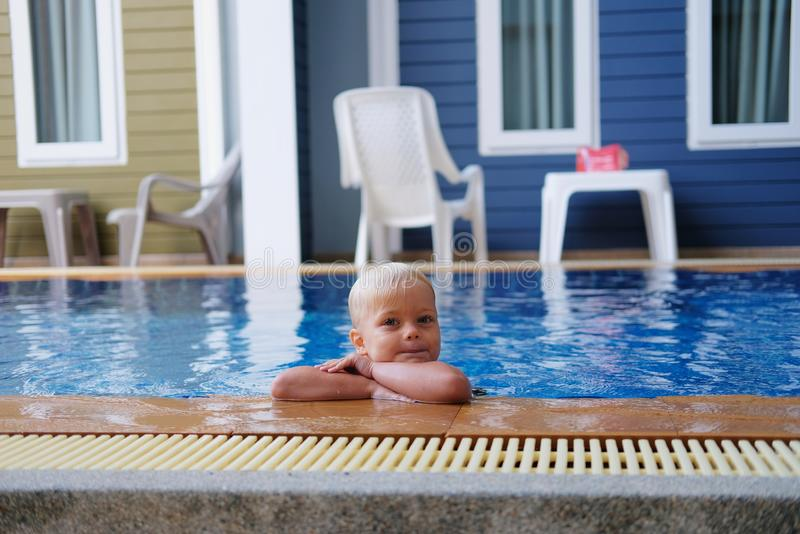 Portrait boy child in swimming pool home summer holiday, outdoors. Portrait of cute little boy with pigment spots on his face in swimming pool home summer stock image