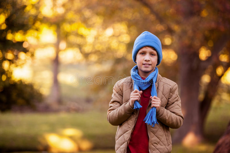 Portrait of boy holding scarf at aprk royalty free stock photos