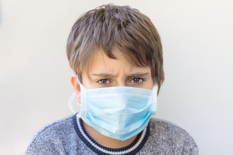 Portrait of a boy in a medical mask. Protection against viruses stock images
