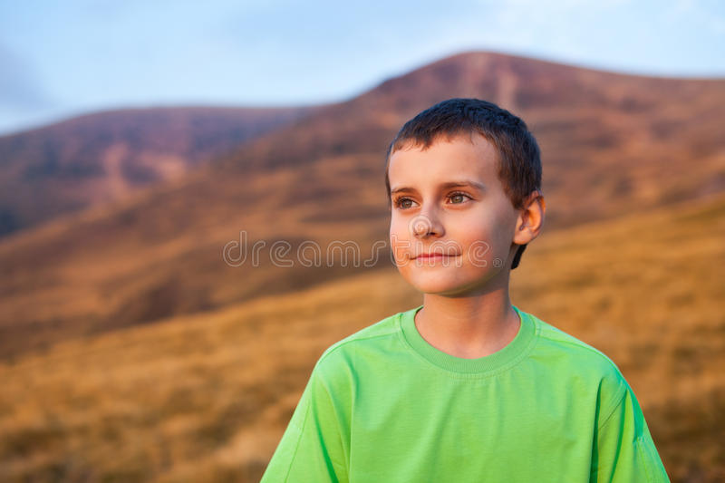 Portrait of a boy on mountains royalty free stock photo