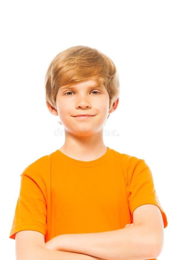 Portrait of a boy in orange shirt on white stock photos
