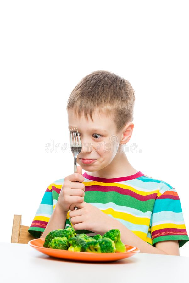 Portrait of a boy with a plate of broccoli, shooting on a white background stock images