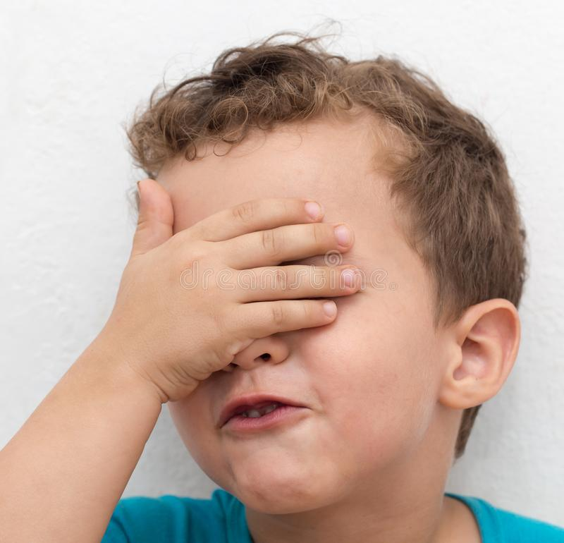 Portrait of a boy`s face contorts stock image