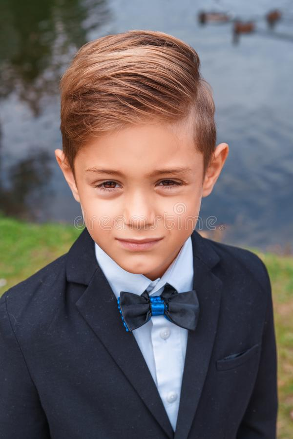 Portrait of a boy in a suit in nature royalty free stock photo