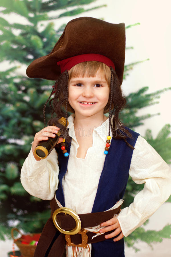 Portrait of the boy in a suit of the pirate. Against xmas tree stock image