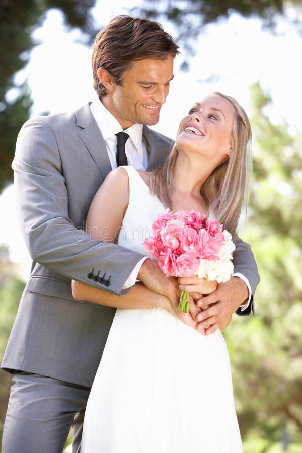 Portrait Of Bridal Couple Outdoors Royalty Free Stock Image