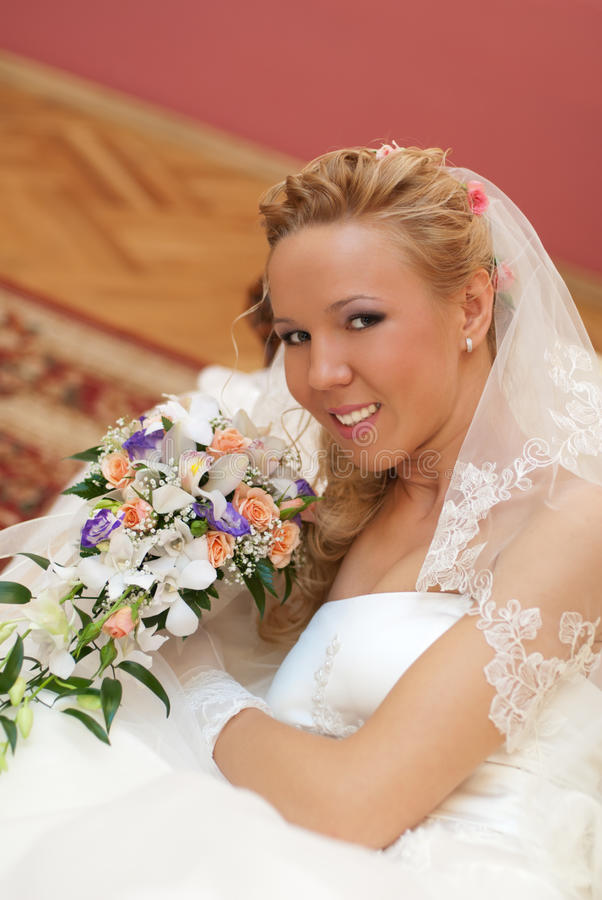 Portrait Of Bride With Bouquet In Hands Indoors Stock Photography