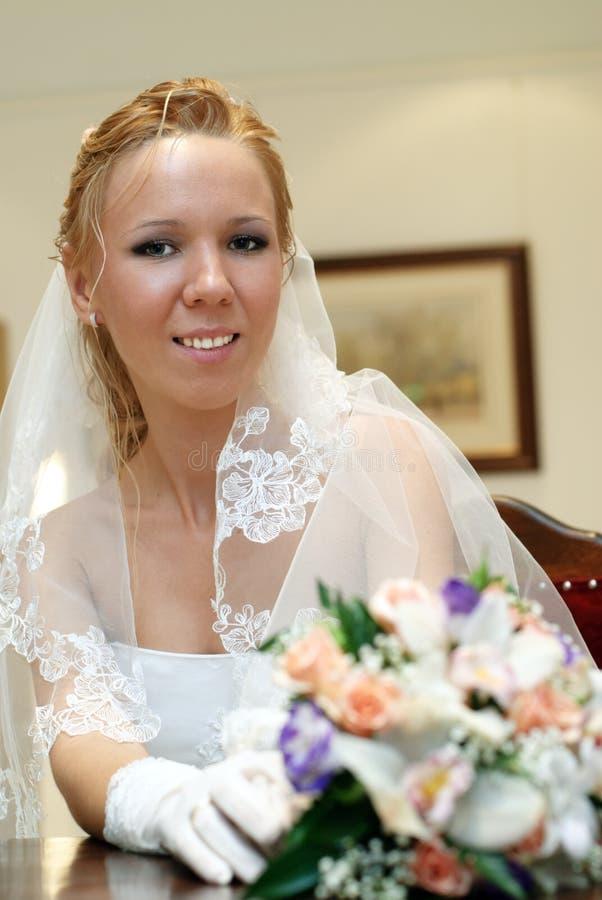 Download Portrait Of Bride With Bouquet In Hands Indoors Stock Photo - Image: 16332740