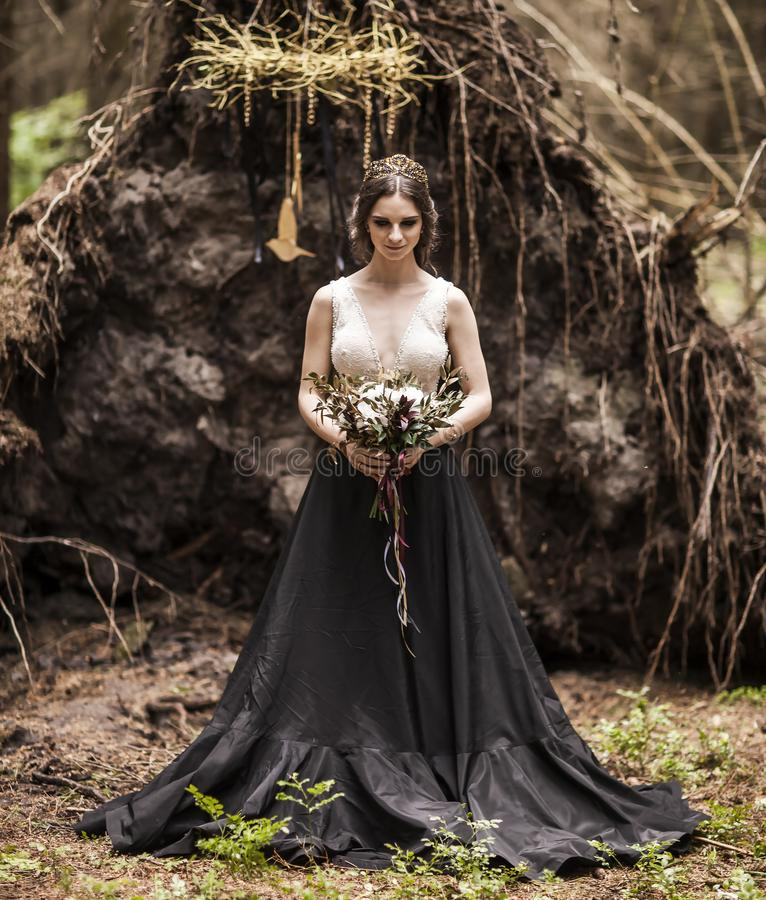 Portrait of a bride dressed in non traditional wedding dress download portrait of a bride dressed in non traditional wedding dress outdoors in the woods stock junglespirit Gallery