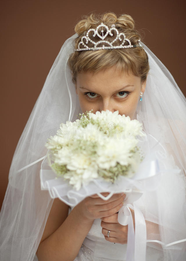 Portrait Of Bride With Bunch Of Flowers At Face Stock Images