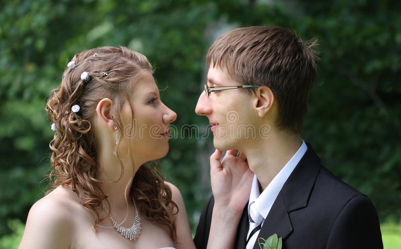 Portrait of bride and groom in summer park royalty free stock photography