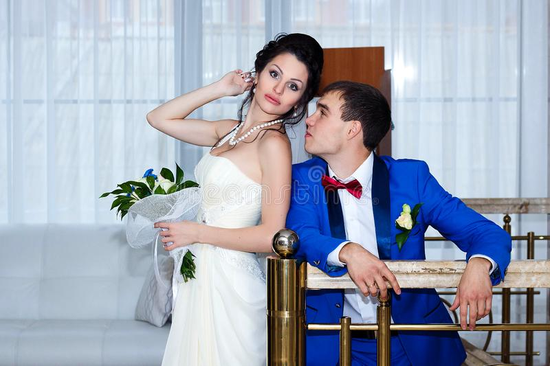 Portrait of the bride and groom at their wedding, indoors royalty free stock image