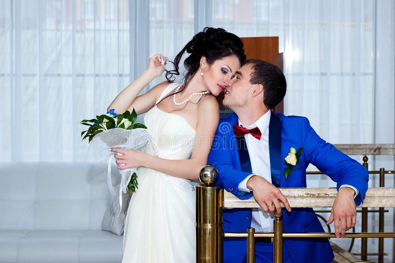 Portrait of the bride and groom at their wedding, indoors stock images