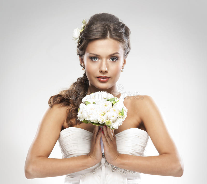 Download Portrait Of A Bride Holding A Bouquet Of Roses Stock Photo - Image: 26523346