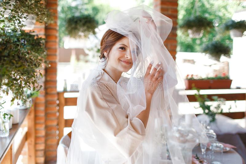 Morning portrait of the cute bride with veil royalty free stock photo