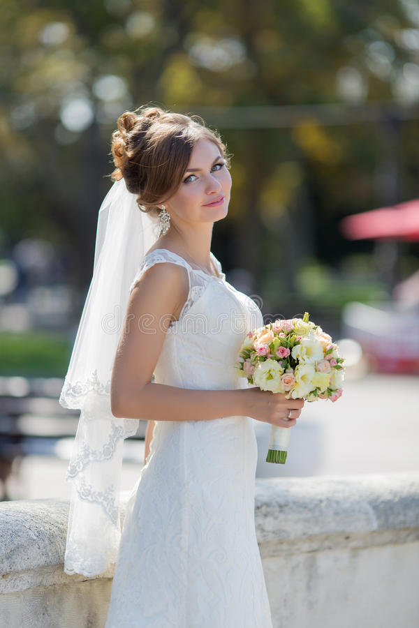 Portrait of bride in park stock image