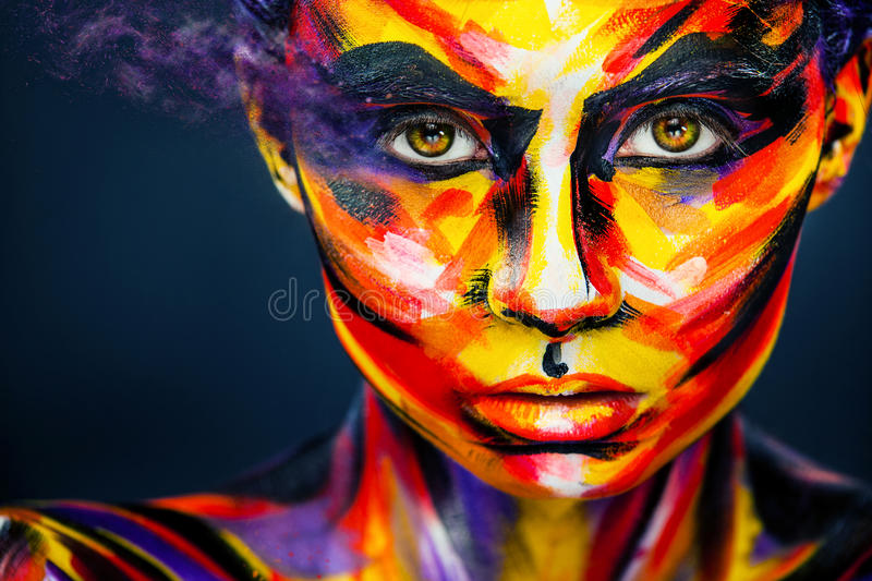Portrait of the bright beautiful girl with art colorful make-up and bodyart royalty free stock image