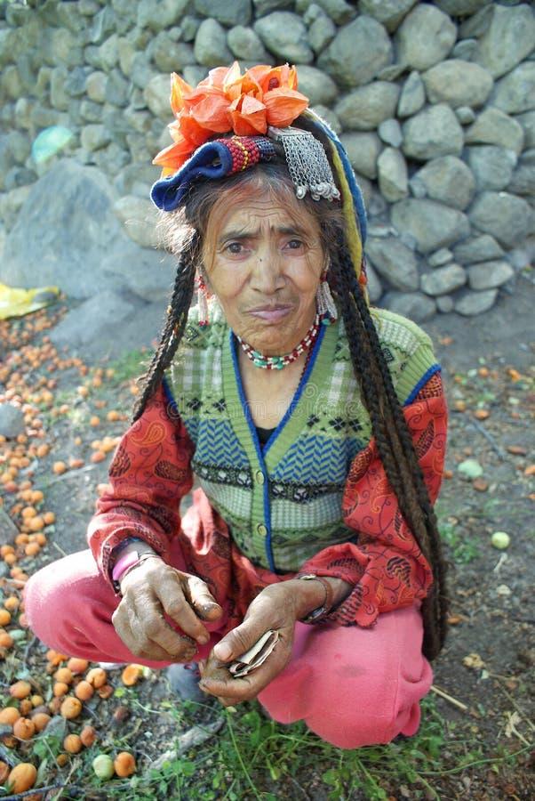 Portrait of Brokpa / Drokpa elderly woman in Dha Hanu, India royalty free stock images