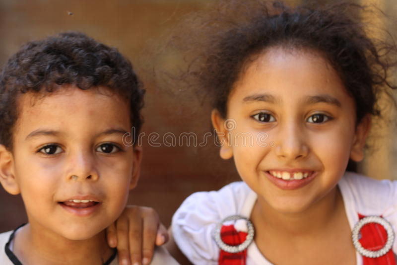 Portrait of a brother and sister children close up at charity event in giza, egypt stock photo