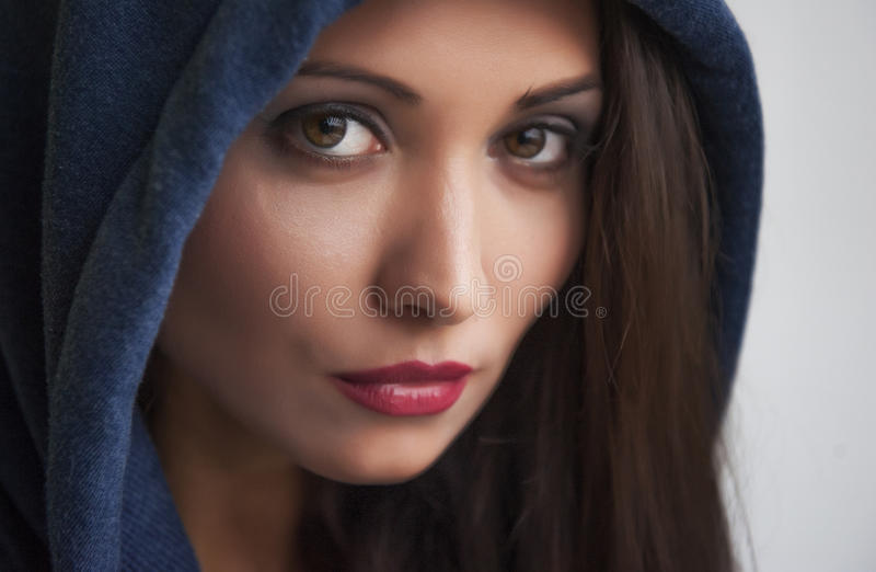 Portrait of a brunette with brown eyes royalty free stock photos