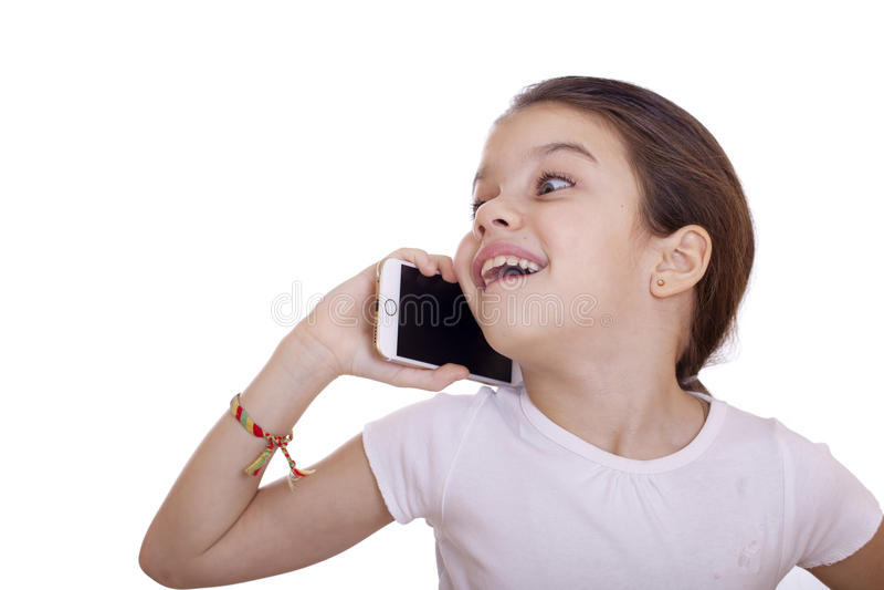 Portrait of brunette Caucasian schoolgirl calling by phone stock photography
