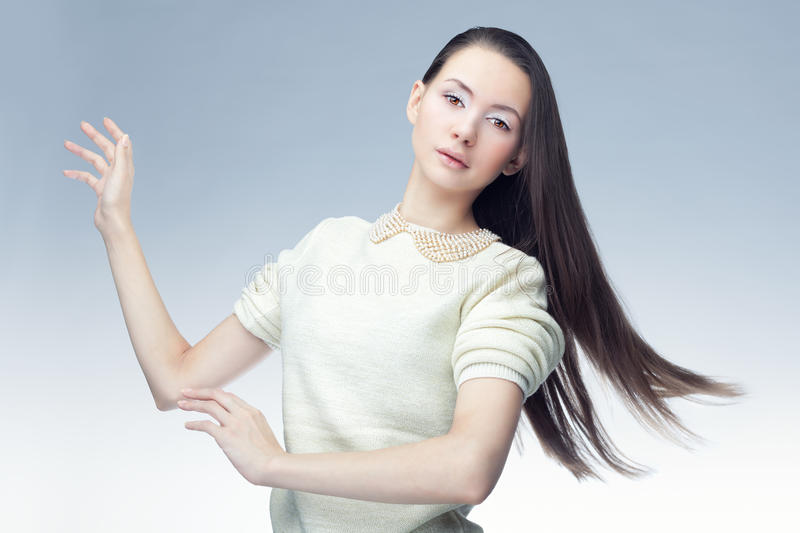 Portrait of a brunette in a cold background royalty free stock photos