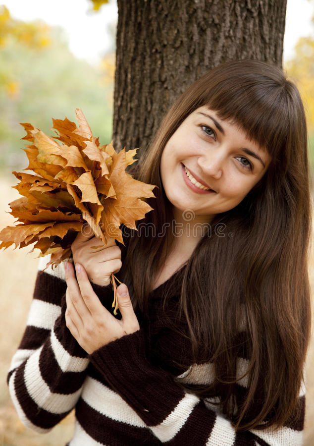 Download Portrait Of Brunette Girl In The Autumn Park. Stock Photo - Image: 21755036