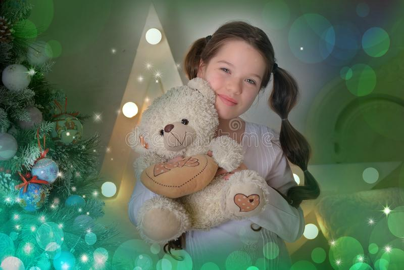 Portrait of brunette girl with teddy bear in hand stock photos