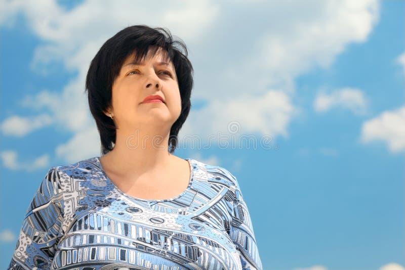 Portrait of brunette plumpy serious woman stock image