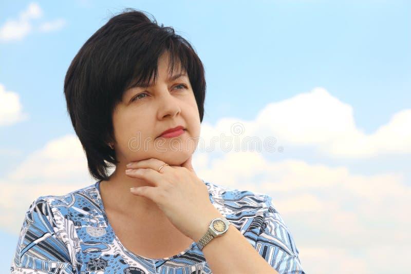 Portrait of brunette plumpy serious woman royalty free stock photo