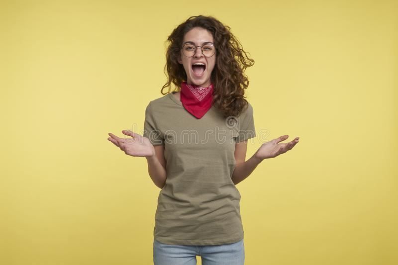 A portrait of brunette screaming crazy woman, she happy abouth something royalty free stock photography