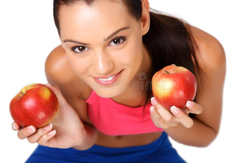 Portrait of a brunette teenager with apples stock photo