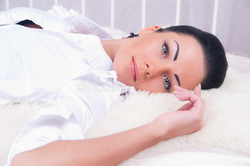 Download Portrait Of Brunette Woman On The Bed. Stock Photo - Image: 25242188