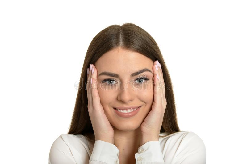 Portrait of brunette woman holding head in hands isolated stock photo