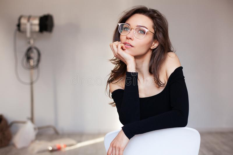 Closeup portrait of woman in glasses royalty free stock photos
