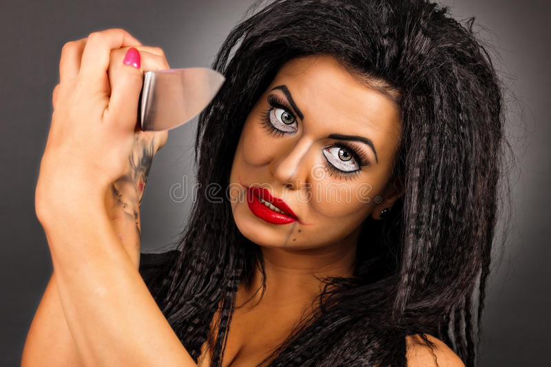 Download Portrait Of A Brunette Young Woman With Creative Make-up Holding Stock Photo - Image: 34491752