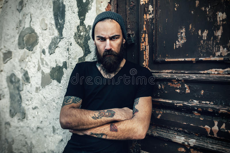 Portrait of brutal bearded man wearing blank t-shirt royalty free stock photos